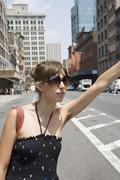 A young woman hailing a taxi, Brooklyn, New York Stock Photos