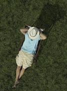 A man sitting on a sun lounger Stock Photos