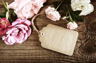 Stock Photo of handmade paper tag with string and roses