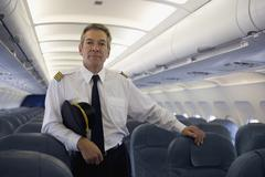 A pilot standing in the cabin of a plane - stock photo