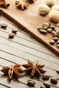 star anise, coffee beans, nutmeg and cinnamon sticks - stock photo
