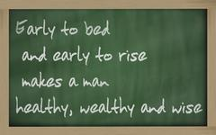 """"""" early to bed and early to rise makes a man healthy, wealthy and wise """" writ - stock photo"""