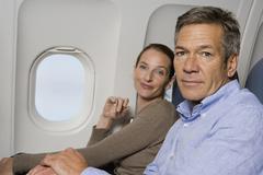 A couple sitting on a plane Stock Photos