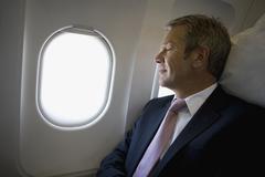A businessman sleeping on a plane Stock Photos