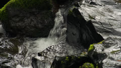 Water pouring over rocks Stock Footage