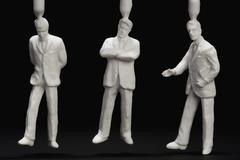 Three plastic businessmen figurines Stock Photos
