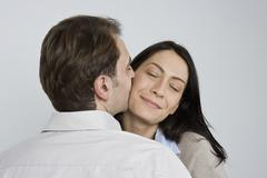 Portrait of a man and woman being affectionate - stock photo
