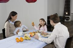 A family eating breakfast Stock Photos