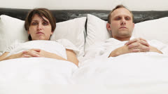 Crazy Couple in bed Loudly laughing Stock Footage