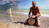 Stock Video Footage of Djembe Drum Player beat rythm on the lonely beach with close up hands