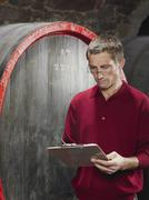 A vintner writing on a clipboard Stock Photos