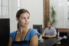 A woman in an office Stock Photos