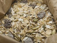 Muesli in a paper bag Stock Photos