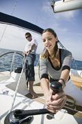 A man and a woman sailing Stock Photos