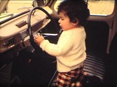 8mm kid driving a Renault car Stock Footage