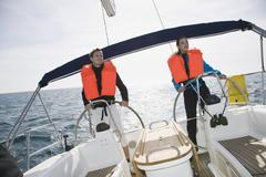A man and a woman sailing - stock photo