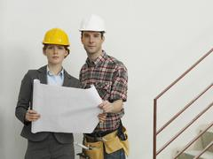 An architect speaking with a construction worker Stock Photos