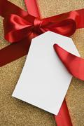 A gift tied with a red ribbon Stock Photos