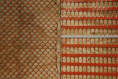 Orange plastic construction netting Stock Photos