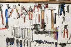 Hand tools arranged on a wall Stock Photos