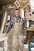 A carpenter standing in a workshop - stock photo