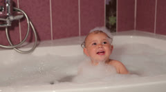 Baby in bath with foam Stock Footage