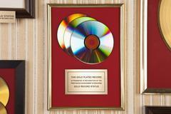 Gold compact disc award Stock Photos