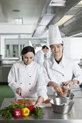 Stock Photo of Two chefs doing prep work in a commercial kitchen