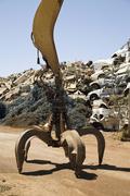 A hydraulic crane in a scrap metal yard Stock Photos