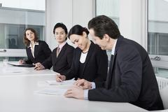 Four business people in a business meeting - stock photo