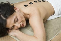A woman having lastone therapy treatment - stock photo