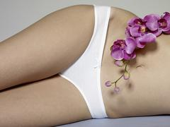 Stock Photo of Midsection of a woman lying down