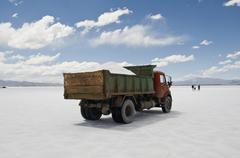A dump truck on a salt flat, Salinas Grandes, Argentina Stock Photos