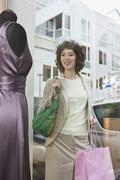 A woman window shopping Stock Photos