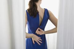 A woman trying on a dress Stock Photos