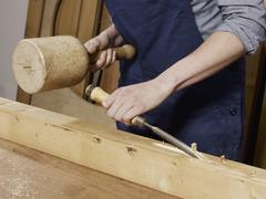 Stock Photo of Detail of a woman chiseling wood