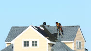 Stock Video Footage of Roofer working on a roof of the house