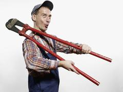 A man holding bolt cutters - stock photo