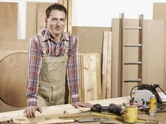 Stock Photo of Portrait of a man standing in a wood workshop