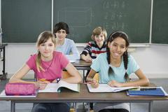 School students sitting in a classroom Stock Photos