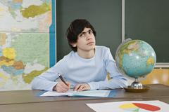 A schoolboy looking up and frowning Stock Photos