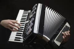 Human hands playing an accordion Stock Photos