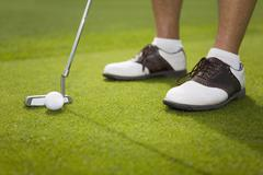 Detail of a golfer putting Stock Photos