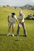 A golf instructor advising a golfer, Palm Springs, California, USA Stock Photos