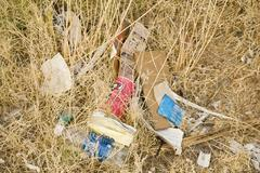 Discarded garbage in nature Stock Photos