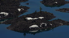 Volcanic islands in Crater Lake Stock Footage