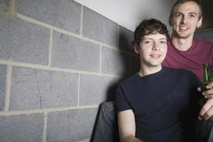 A young gay couple sitting in a stairway together Stock Photos