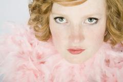 Portrait of a young woman wearing a pink feather boa Stock Photos