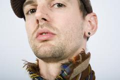 A portrait of a man wearing a hat and scarf Stock Photos
