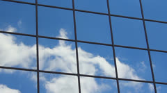 Extreme close up of clouds reflecting off office building windows. Stock Footage